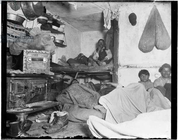 "Lodgers in a crowded Bayard Street tenement - ""Five cents a spot."" (b/w photo)"