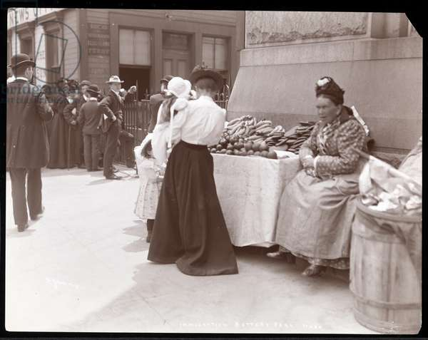 View of a fruit peddler at Battery Park, presumably awaiting immigrants from Ellis Island, New York, c.1901 (silver gelatin print)
