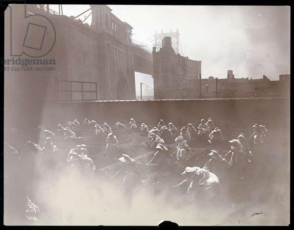 Girls working on a rooftop vegetable garden, Manhattan Bridge visible beyond, New York, 1910 (silver gelatin print)