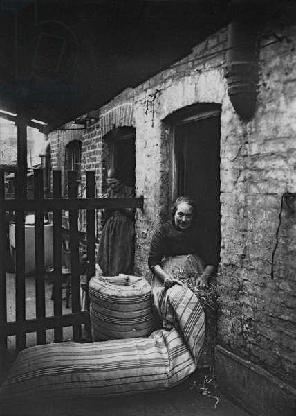 Ma Rolinson of Bethnal Green Making Mattresses, 1890 (b/w photo)