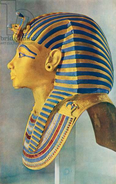Tutankhamun.  The solid gold portrait mask which covered the head of the young Pharaoh's Mummy.  Egyptian pharaoh of the 18th dynasty, ruled c. 1332 BC – 1323 BC.  From The Illustrated London News, Silver Jubilee Record Number, 1910 - 1935