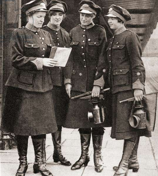 Women working as porters, guards and inspectors on the London underground railway during World War One, from The Pageant of the Century, pub.1934