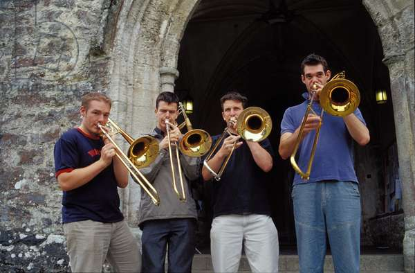 Trombone ensemble rehearsing outside
