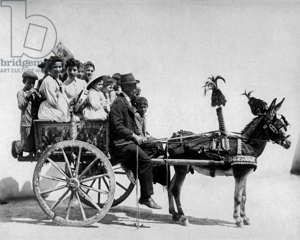 People on a donkey cart, Naples, Italy