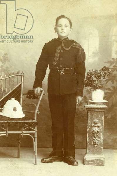 Boy in military uniform