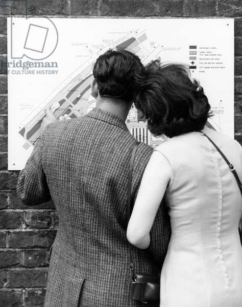 COUPLE STUDYING A MAP