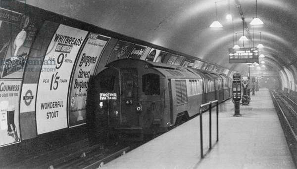 A tube a train at a london underground platform at Euston