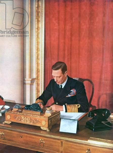 King George VI at his desk in naval uniform, 1942