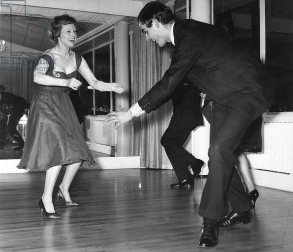 Anna Neagle dancing the twist with Grenville Collins