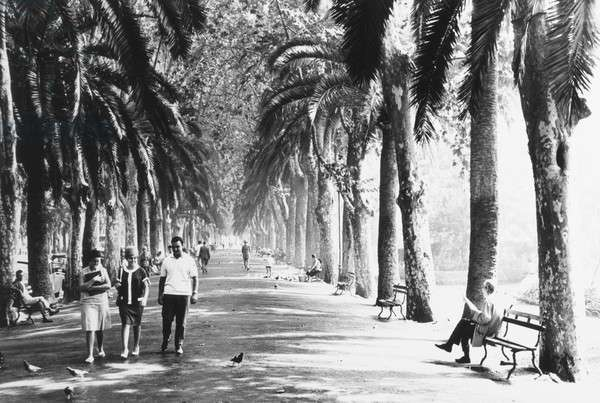 People going for a stroll in Malaga, Spain