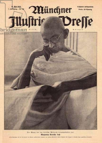 Mahatma Gandhi reading a newspaper
