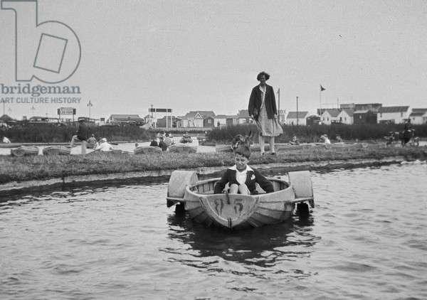 Boy in a pedalo boat