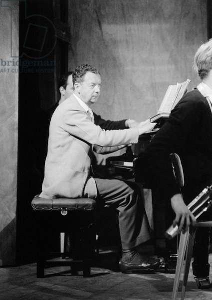 Benjamin Britten working on his score