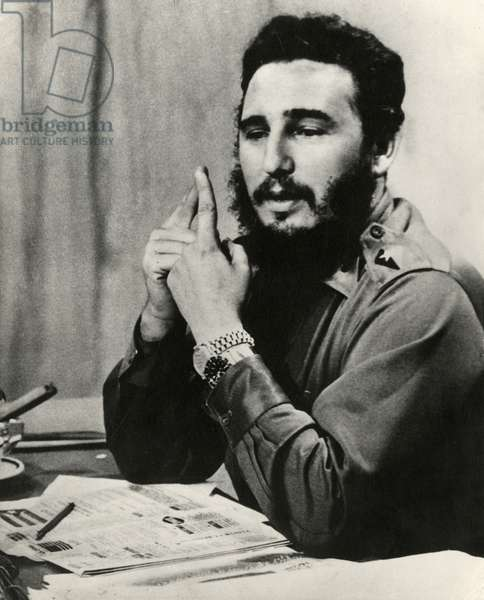 FIDEL CASTRO AT DESK