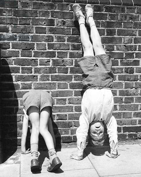 Boys doing handstands on a Balham street, SW London
