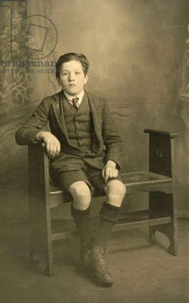 A smartly attired boy