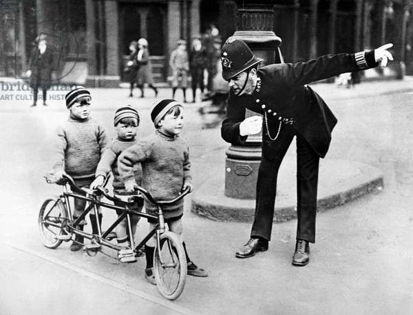 Policeman giving directions to children