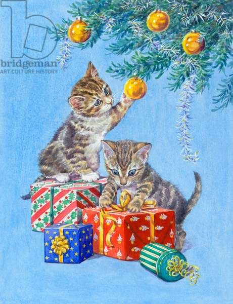 Two kittens playing with Christmas parcels