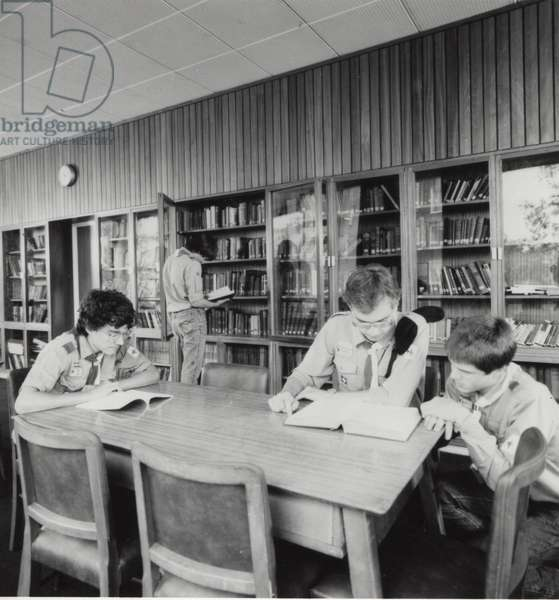 Scouts in library at Baden Powell House, London