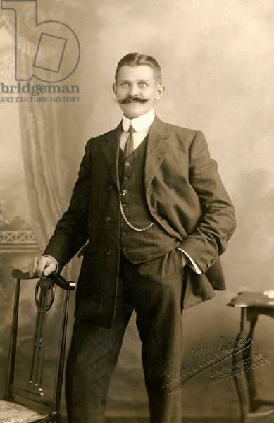 Smartly dressed man with a magnificent moustache.