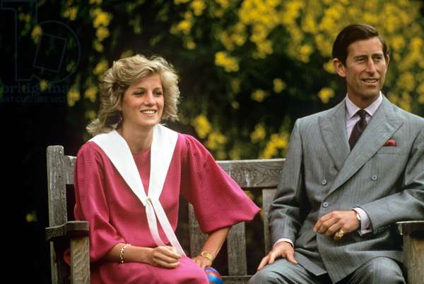 Prince Charles and Princess Diana on a bench