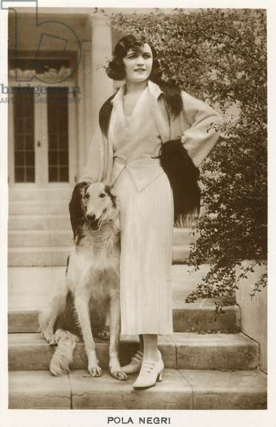 Pola Negri, film and theatre star, with her dog