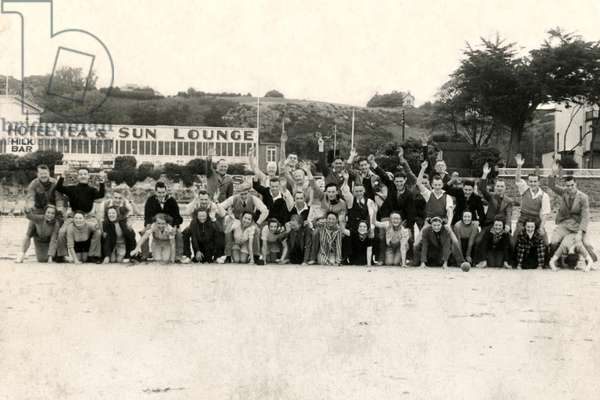 Holidaymakers enjoy a group photograph on the beach