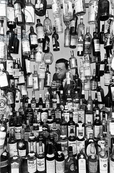 Sunday Mirror writer Stanley Shivas with the 137 best selling Scottish whiskeys. 13th October 1967 (b/w photo)
