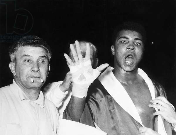 Muhammad Ali Boxing in London at Wembley Stadium for his fight with Henry Cooper predicts that he will in the fifth Round, 18th June 1963 (b/w photo)