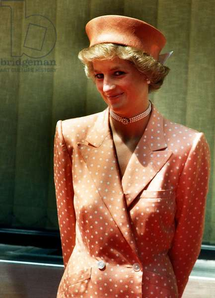 Princess Diana Princess of Wales wearing orange and white polka dot dress with matching hat, July 1988 (photo)