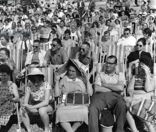 Every seat was taken at Hastings, and plenty had to stand. But they didn't mind that one little bit! August 1960 (b/w photo)