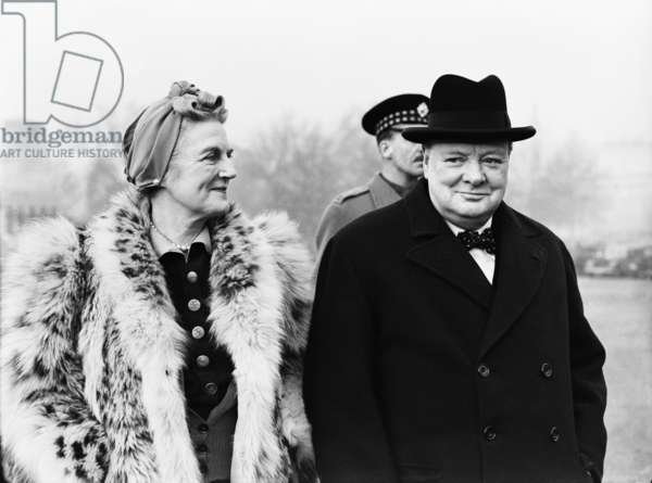 British Prime Minister Winston Churchill, accompanied by his wife Lady Churchill, inspecting the 1st American Squadron of the Home Guard on Horse Guards Parade during the Second World War.9th January 1941 (b/w photo)