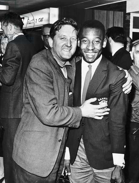 Pele Brazilian football player gets a welcome hug from a fan at Glasgow airport 1966 (photo)