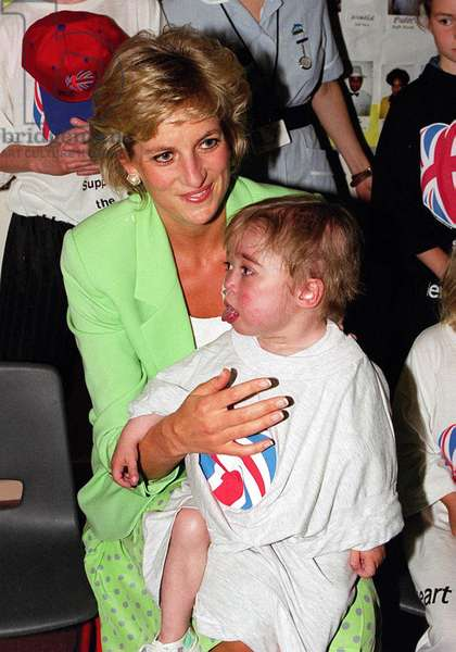 Princess Diana with Darius Wyke sitting on her knee on a visit to a Children's Hospital ward June 1996 (photo)