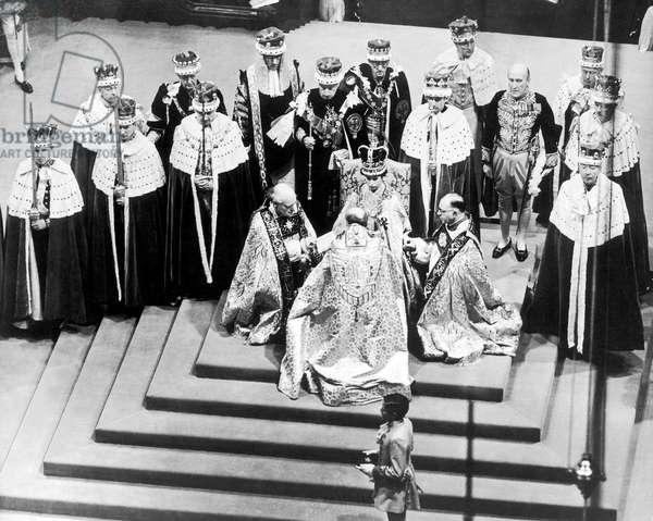 Coronation of Elizabeth II: The Duke of Edinburgh kneels in homage to his wife the new queen 2nd June 1953 (b/w photo)