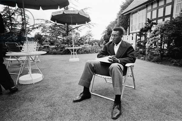 Brazilian football star Pele relaxes in an English country garden at the Brazilian team hotel in in Lymm, Cheshire during the 1966 World Cup tournament in England. 7th July 1966 (photo)
