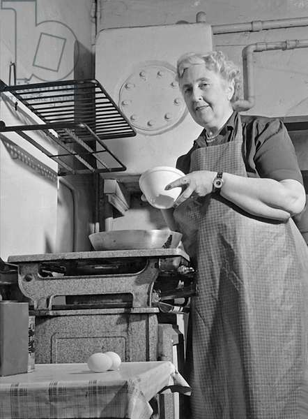 Agatha Christie Cooking, 1950 (b/w photo)