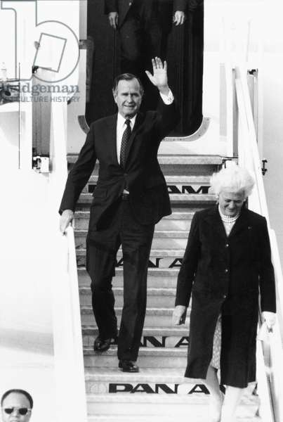 President George Bush Sr arrives with wife Barabara at Heathrow Airport, May 1989 (b/w photo)
