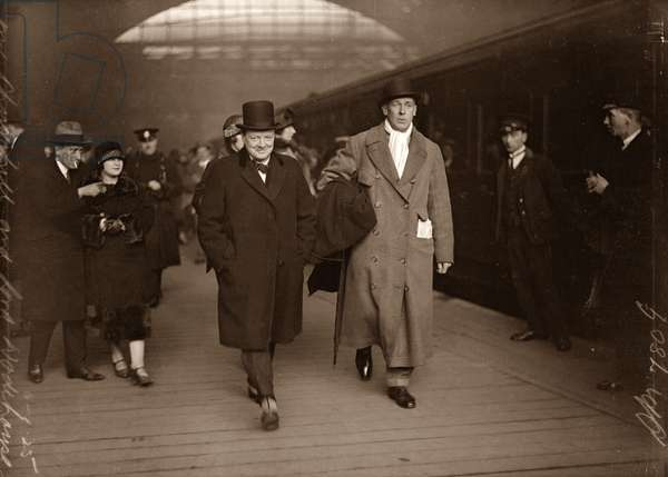 Winston Churchill with Lord Wodehouse at Victoria Train Station en route to Paris, January 1925 (b/w photo)