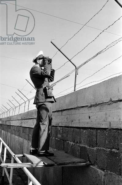A soldier patrolling the Berlin Wall, October 1961 (b/w photo)