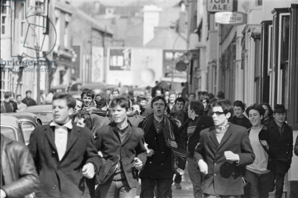 Mods running through the streets of Brighton, 18th April 1965 (b/w photo)