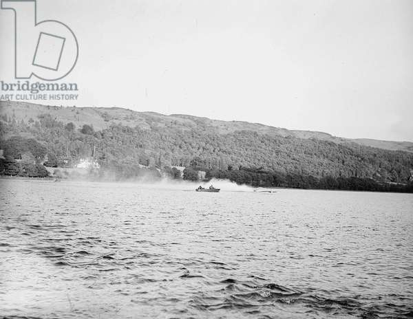 Sir Malcolm Campbell conducts speed trials of his boat Bluebird on Coniston Water, 1947 (b/w photo)