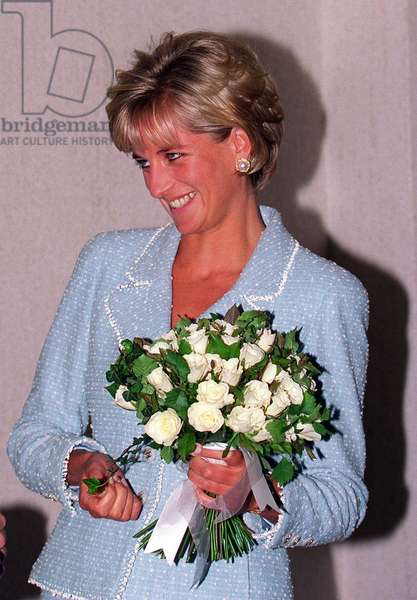 Princess Diana receives a Bouquet of roses Princess Of Wales Rose named after her from the British Lung Foundation, April 1997 (photo)