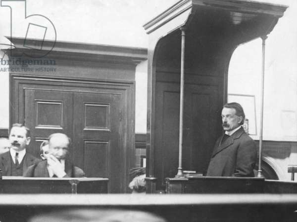 David Lloyd George, Chancellor of the Exchequer, seen here in the witness box at Bow Street, under cross examination by Miss Christabel Pankhurst during the trial of Mrs Pankhurst, Mrs Drummond and Miss Pankhurst, 22nd October 1908 (b/w photo)