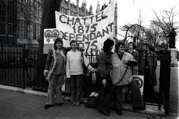 Womens Lib 1970s  Protestors Demonstrators chain themselves to Sylvia Pankhurst statue railings  April 1975 Womens Rights Movement