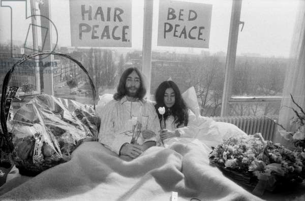 John Lennon and his wife Yoko Ono are having a week's love-in in their room at the Hilton Hotel, March 1969 (b/w photo)