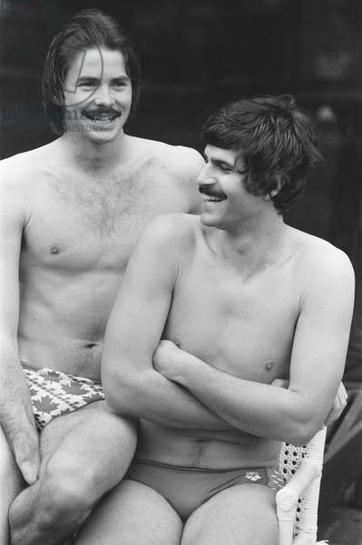 Mark Spitz, USA Olympic Champion, seven x gold medals at the 1972 Munich Olympic Games, pictured with David Wilkie, British Olympic Champion, 200 metre breaststroke 1976 Montreal Olympics. Photocall ahead of meeting in France to discuss 12 month schedule for Team Arena, pictured together in London, 19th April 1978 (b/w photo)