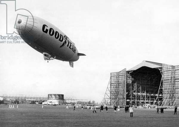 The Goodyear Europa airship rises above its hangar at RAF Cardington formerly the Royal Airship Works - the same hangar that once housed the ill-fated R101. March 1972