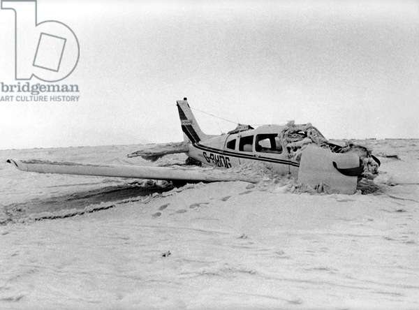 RAF Mountain Rescue and Police search for the wreckage of a crashed light aircraft. The wreckage of a war lies beneath the soft earth of the Cheviot slopes. Consciously ignored by the censored Press of World War Two dozens of planes plunged to their destruction and sank into bogs. More than 25 - both Allied and German - are beneath the marshy soil and their names bear out the aggression of war: Spitfire, Flying Fortress, Swordfish... But when the war ended, the accidents stopped. In the 30 years since the war there had only been two air crashes over the misty hills, this Tuesday's nosedive into Hedgehope Hill was one of them. But rumours persist about the strange weather conditions and freak disturbances between St Abb's Head, where the men went off course and the Cheviots. Does the North have a Bermuda Triangle of its own ? As Department of Trade Inspectors stood by in Wooler to begin examining the Piper Cherokee wreckage, experts answered unequivocally: No ! The aircraft, that was flying from Edinburgh to Sunderland and crashed on the 2,348 ft. Hedgehope Hill is pictured, 14/02/1979 (b/w photo)