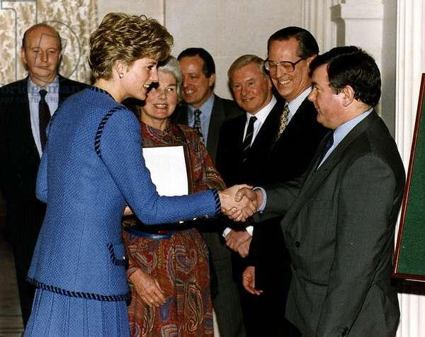 Richard Stott the Daily Mirror editor shakes hands with Princess Diana, July 1992 (photo)